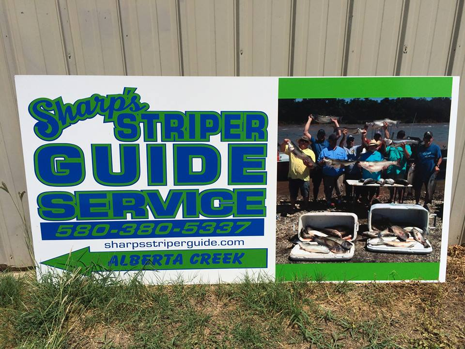 Sign saying Striper Guide Service